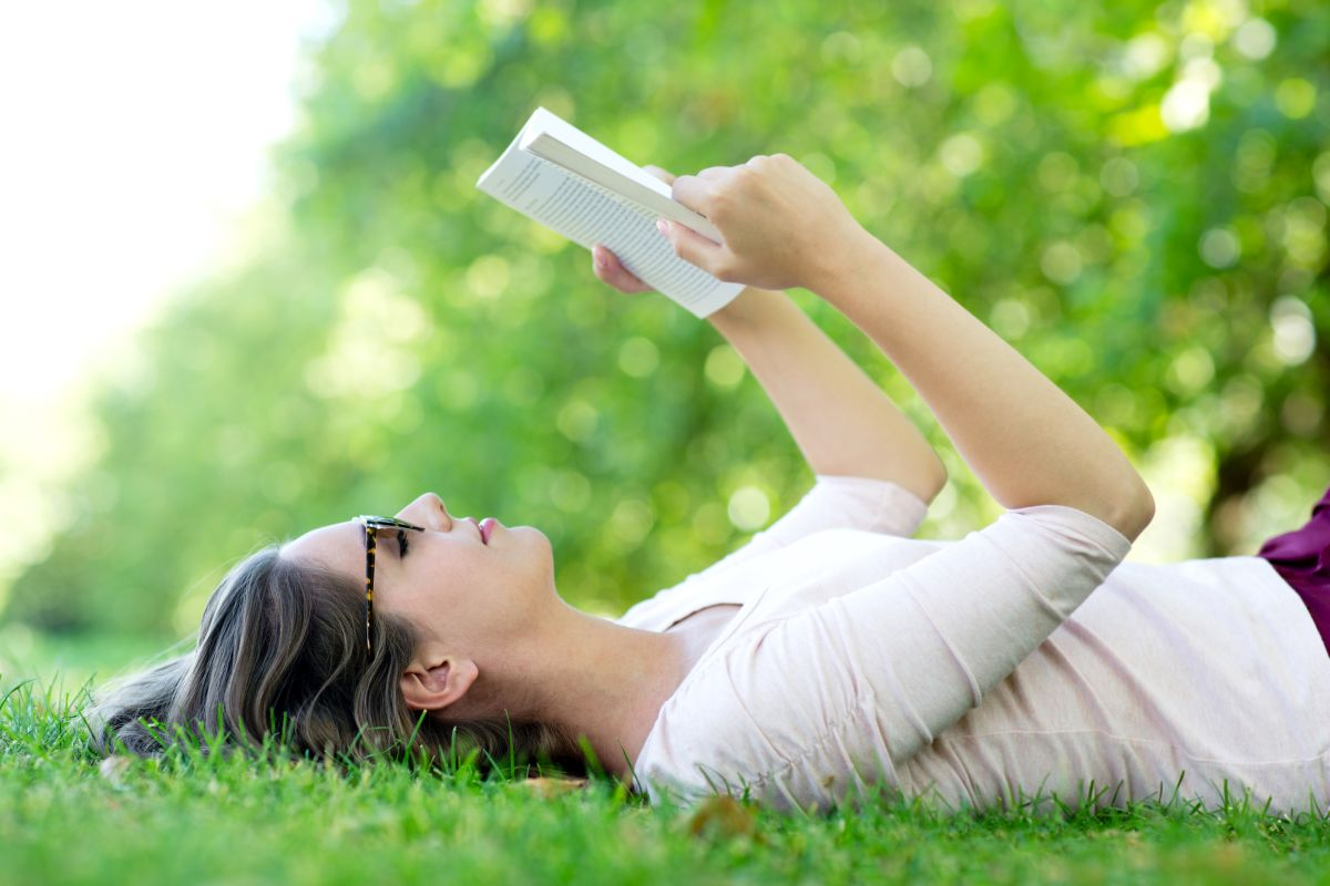 Summer woman reading outdoors